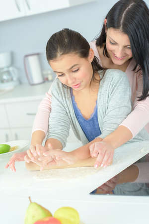 mother and daughter cooking dinner Stockfoto