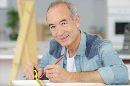 senior man with tape measure