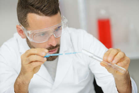 portrait of confident mid adult doctor working in a lab 스톡 콘텐츠