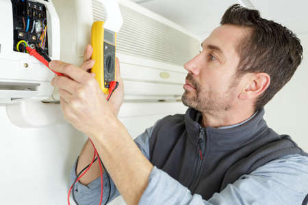 handyman repairman conducting residential hvac repair