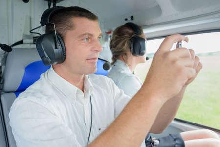man recording video of his take-off in light aircraft