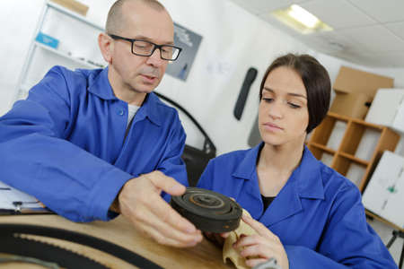 young woman apprentice with a tool mechanic