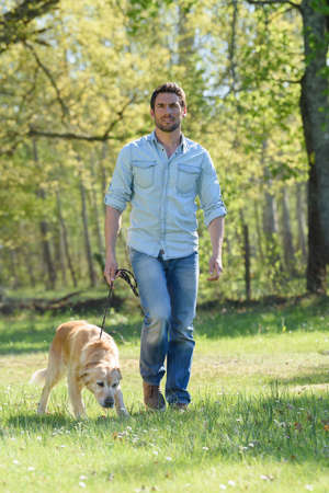 man walking his dog at the park