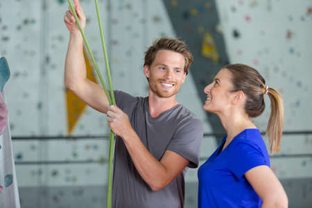 wall climbing trainer checking the rope 스톡 콘텐츠