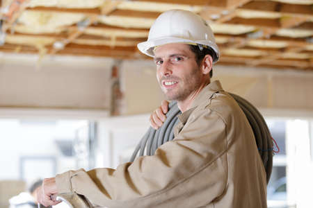 builder holding a spool wire