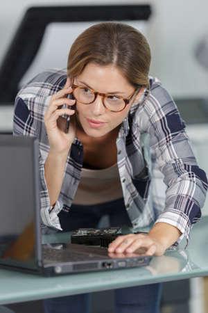 a woman on the phone Banco de Imagens