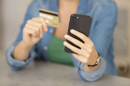 woman using credit card and with smartphone