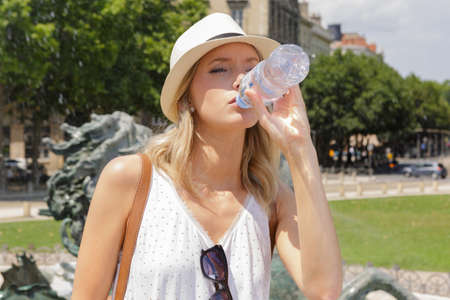 picture of a female tourist drinking water