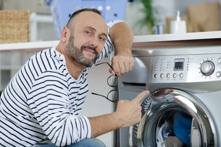 man pointing a washing machine