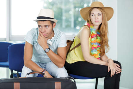 couple traveler waiting for airplane