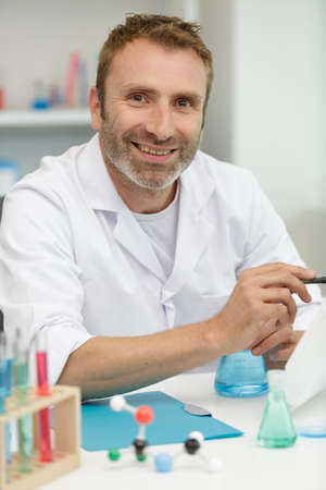 smiling lab technician giving thumbs up