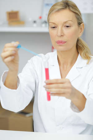 a researcher using a pipette Stock Photo