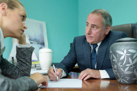 funeral director in meeting with young female client