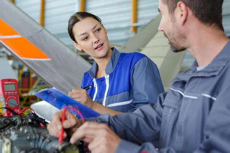 aero engineer and apprentice working in hangar