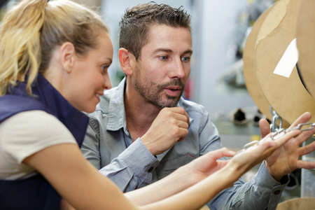 couple woman and man in hardware store Stock Photo