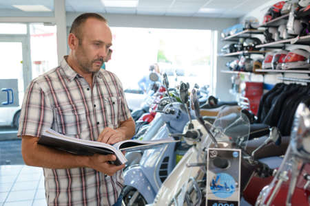 salesman with client in bike shop