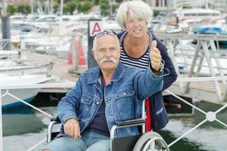senior couple in wheelchair during vacations
