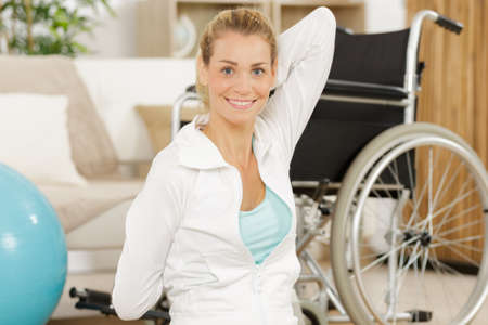 young woman doing exercise with a fitball in a gym Stock Photo