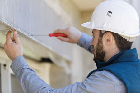 male hand screwing a screw Stock fotó