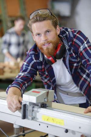 Man using equipment at wood factory Stock Photo