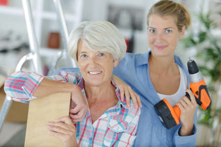 Woman and and her daughter renovating their home