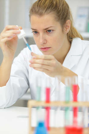 woman working with pipettes in a lab