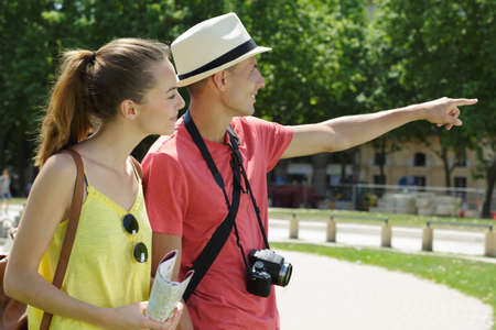 Tourist couple in park pointing into distance