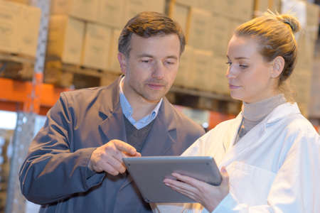 Warehouse and tablet Stock Photo