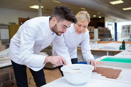 two chefs making chocolate box