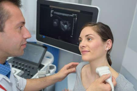 young woman doing neck ultrasound examination at hospital Zdjęcie Seryjne