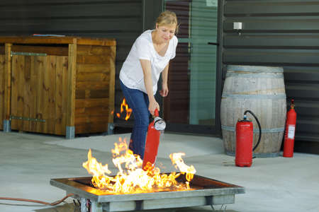 woman is extinguishing fire drill