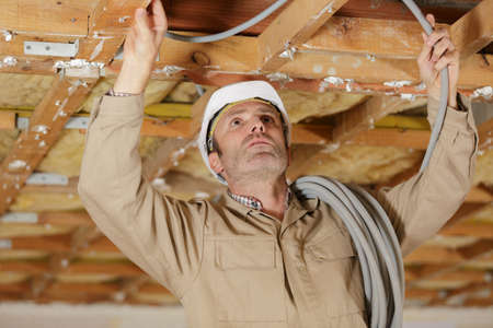 man working with cables indoors