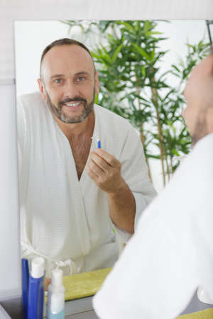 Man shaving in a mirror 写真素材