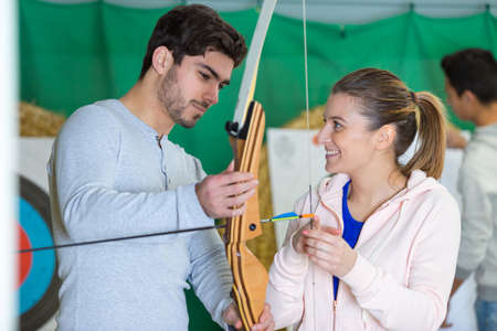Portrait of a couple practicing archery