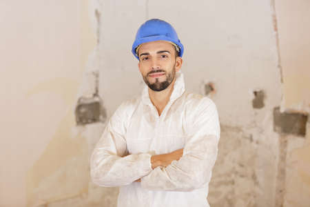 Portrait of young male builder on renovation site