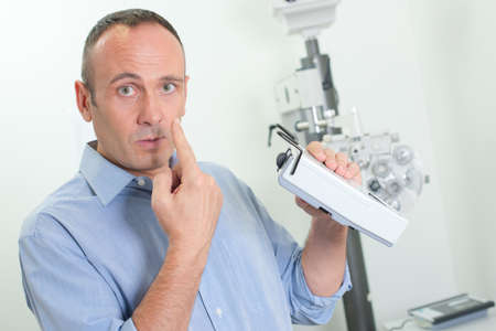 ophthalmology pointing at his eye