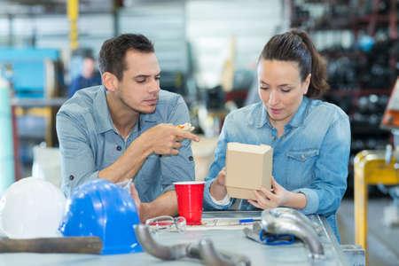 two worker in factory having a break Standard-Bild - 134364759