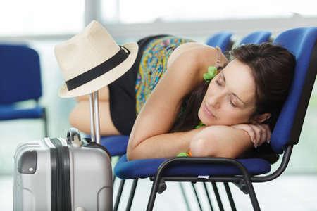 man sleeping on bench in airport 版權商用圖片