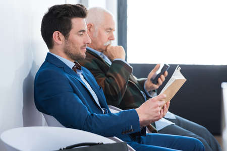 two businessmen waiting for a job interview
