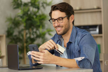 a happy man buying online