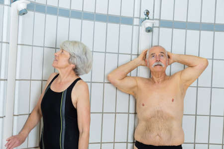 senior couple happy to take a shower after swimming 版權商用圖片