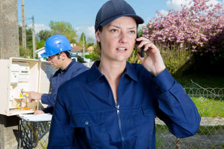 worried female contractor using phone Reklamní fotografie