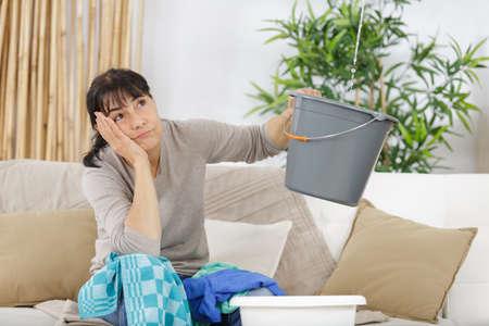 desperate woman having water leaks Stock Photo