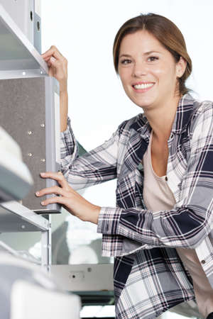 smiling thirty years old woman looking for folder
