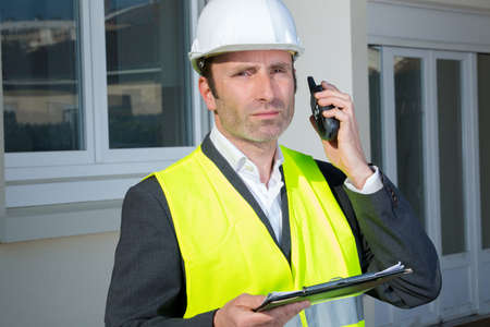 engineer check electrical systems talk walkie-talkie