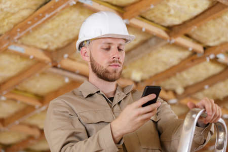 portrait of male construction worker on the phone