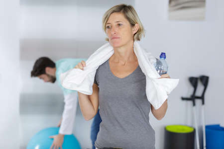 mature woman relaxing after sport Stock Photo
