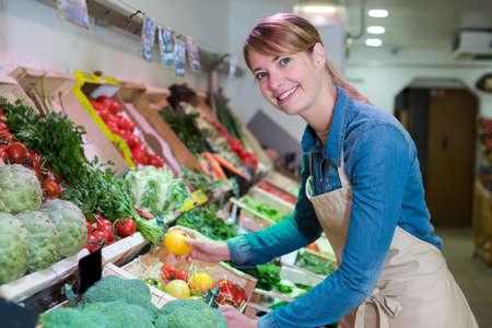 young attractive fruit market saleswoman