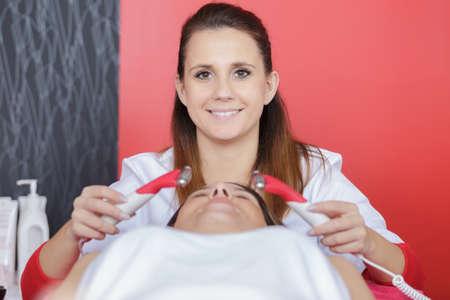 woman giving a facial treatment