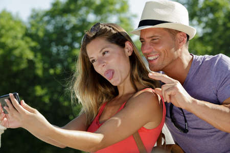 couple doing silly and funny faces while taking selfie
